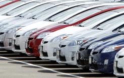 A row of new 2010 Toyota Prius hybrid vehicles sit for sale in the car lot at the Toyota dealership in El Cajon, California in this file photo dated March 9, 2010. REUTERS/Mike Blake