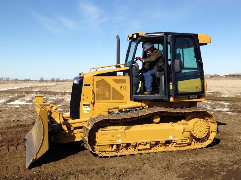 North Dakota Governor Jack Dalrymple prepares to drive a bulldozer to break ground on a new diesel refinery in Dickinson, North Dakota, March 26, 2013. REUTERS/Ernest Scheyder