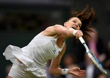 Britain Tennis - Wimbledon - All England Lawn Tennis & Croquet Club, Wimbledon, England - 29/6/16 Poland's Agnieszka Radwanska in action against Ukraine's Kateryna Kozlova REUTERS/Tony O'Brien