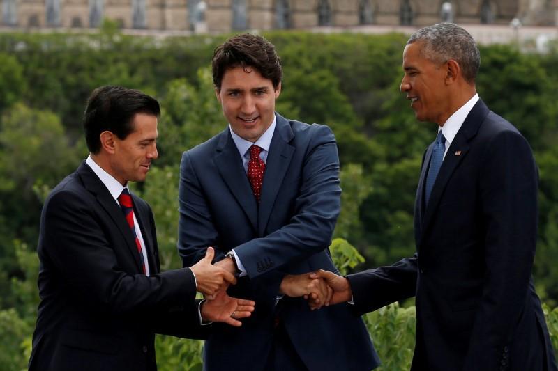 North America leaders mount strong defense of trade despite threats