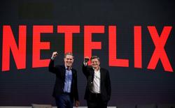 Reed Hastings (L), co-founder and CEO of Netflix, and Ted Sarandos, Netflix chief content officer, pose for photographs during a news conference in Seoul, South Korea, June 30, 2016.  REUTERS/Kim Hong-Ji