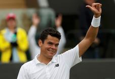 Britain Tennis - Wimbledon - All England Lawn Tennis & Croquet Club, Wimbledon, England - 30/6/16 Canada's Milos Raonic celebrates winning his match against Italy's Andreas Seppi REUTERS/Paul Childs