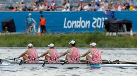 Russia's team row during the men's rowing quadruple sculls heat at the Eton Dorney during the London 2012 Olympic Games July 28, 2012. REUTERS/Darren Whiteside