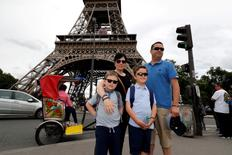 Michelle Stevenson, her companion John Williams and their two sons Baily (9 years old) and Casey (6 years old), from Essex England, winner of the HomeAway contest for a night at the Eiffel Tower, pose as they arrive at the Eiffel Tower in Paris, June 29, 2016.   REUTERS/Philippe Wojazer