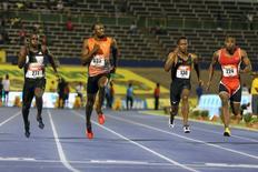 Athletics - Jamaica National Trials - Kingston - 01/07/16 (L-R) Jevaughn Minzie, Usain Bolt, Senoj-Jay Givans and Dexter Lee in action during men's 100m semi-final race. REUTERS/Gilbert Bellamy
