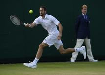 Britain Tennis - Wimbledon - All England Lawn Tennis & Croquet Club, Wimbledon, England - 1/7/16  Croatia's Marin Cilic in action against Slovakia's Lukas Lacko REUTERS/Tony O'Brien