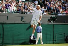 Britain Tennis - Wimbledon - All England Lawn Tennis & Croquet Club, Wimbledon, England - 2/7/16 USA's Sam Querrey celebrates winning his match against Serbia's Novak Djokovic REUTERS/Paul Childs