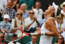 Britain Tennis - Wimbledon - All England Lawn Tennis & Croquet Club, Wimbledon, England - 4/7/16 Germany's Angelique Kerber celebrates winning her match against Japan's Misaki Doi REUTERS/Stefan Wermuth