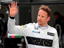 Formula One - Russian Grand Prix - Sochi, Russia - 30/4/16 - McLaren Honda Formula One driver Jenson Button of Britain waves after the qualifying session. REUTERS/Yuri Kochetkov