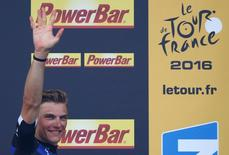 Cycling - Tour de France cycling race - The 237.5 km (147.5 miles) Stage 4 from Saumur to Limoges, France - 05/07/2016 -  Etixx-Quickstep rider Marcel Kittel of Germany reacts on podium after winning the stage.  REUTERS/Juan Medina