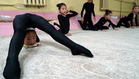 Young contortionists practice at a training school in Ulaanbaatar, Mongolia, July 4, 2016.  REUTERS/Natalie Thomas