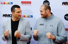 Boxing - Vladimir Klitschko and Tyson Fury News Conference - Cologne, Germany - 28/4/16 - Vladimir Klitschko and Tyson Fury at a news conference  REUTERS/Wolfgang Rattay