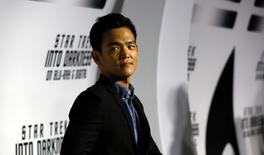 "Cast member John Cho poses at the party for the release of the Blu-Ray DVD of ""Star Trek Into Darkness"" at the California Science Center in Los Angeles, California September 10, 2013.   REUTERS/Mario Anzuoni"