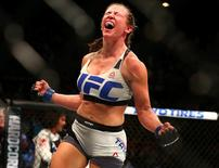 March 5, 2016; Las Vegas, NV, USA; Miesha Tate celebrates her victory by submission against Holly Holm during UFC 196 at MGM Grand Garden Arena. Mark J. Rebilas-USA TODAY Sports