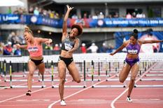 zJul 8, 2016; Eugene, OR, USA; Brianna Rollins (center) and Kristi Castlin (right) and Queen Harrison (left) finish first, third, and fourth respectively the 2016 U.S. Olympic track and field team trials at Hayward Field. Mandatory Credit: James Lang-USA TODAY Sports
