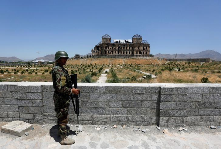 An Afghan National Army (ANA) soldier stands guard after the inauguration of the reconstruction project to restore the ruins of historic Darul Aman palace, in Kabul, Afghanistan May 30, 2016. REUTERS/Omar Sobhani