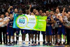 Basketball - FIBA Olympic Qualifying Tournament (OQT) - France v Canada - Manila, Philippines - 10/07/2016. Players from France celebrate as they the hold a ticket sign to the Rio Olympics after beating Canada. REUTERS/Romeo Ranoco