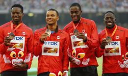 File photo of Canada's Justyn Warner, Brendon Rodney, Andre de Grasse and Aaron Brown, bronze medallists, posing on the podium after the men's 4 x 100 metres relay event during the 15th IAAF World Championships at the National Stadium in Beijing, China, August 30, 2015. REUTERS/Damir Sagolj