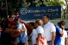 Kimberly-Clark employees stand outside the company in Maracay, Venezuela, July 10, 2016. REUTERS/Carlos Jasso