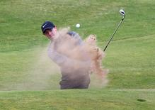 Golf-British Open - Northern Ireland's Rory McIlroy plays out of a bunker on the 18th hole during a practice round - Royal Troon, Scotland, Britain - 13/07/2016.  REUTERS/Craig Brough