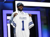 Apr 28, 2016; Chicago, IL, USA; Ezekiel Elliott (Ohio State) after being selected by the Dallas Cowboys as the number four overall pick in the first round of the 2016 NFL Draft at Auditorium Theatre. Mandatory Credit: Kamil Krzaczynski-USA TODAY Sports