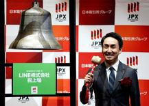 Line Corp. CEO Takeshi Idezawa poses as he rings a bell during a ceremony to mark the company's debut on the Tokyo Stock Exchange in Tokyo, Japan July 15, 2016.  REUTERS/Issei Kato