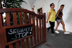 "A ""Stop Segway"" sign hangs on a fence of a restaurant in Prague, Czech Republic, July 19, 2016.   REUTERS/David W Cerny"