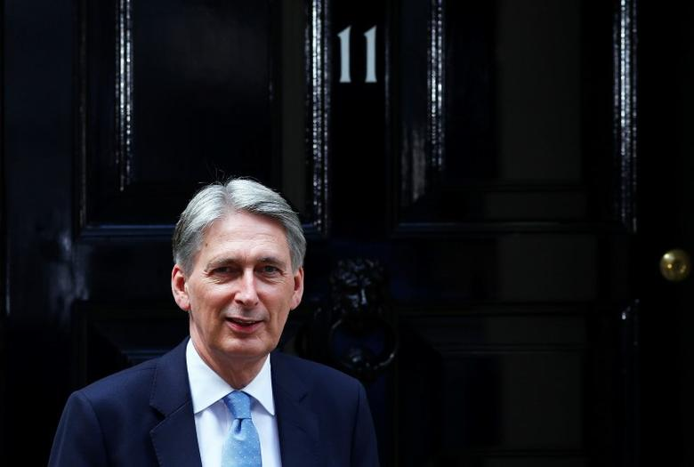 Britain's new Chancellor of the Exchequer, Philip Hammond, waits to greet U.S. Treasury Secretary Jack Lew, at number 11 Downing Street in London, Britain July 14, 2016.  REUTERS/Neil Hall