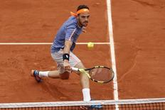 Tennis - French Open - Roland Garros - Nick Kyrgios of Australia v Marco Cecchinato of Italy - Paris, France - 22/05/16. Marco Cecchinato returns the ball. REUTERS/Benoit Tessier