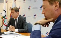 Russian Olympic Committee head Alexander Zhukov (L) and Russian Olympic Committee Vice President Vladimir Kozhin attend a meeting with members of executive board of the Russian Olympic Committee to announce names of sportspeople selected to go to the 2016 Rio Games, in Moscow, Russia, July 20, 2016. REUTERS/Sergei Karpukhin