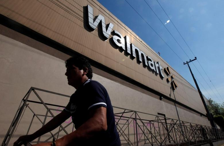 A person walks outside a Wal-Mart store in Mexico City January 11, 2013. REUTERS/Edgard Garrido/File Photo
