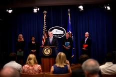 (L to R) U.S. Attorney Eileen M. Decker of the Central District of California, U.S. Attorney General Loretta E. Lynch, FBI Deputy Director Andrew McCabe, Assistant Attorney General Leslie R. Caldwell, and IRS Criminal Investigation Chief Richard Weber announce the filing of civil forfeiture complaints seeking the forfeiture and recovery of more than $1 billion in assets associated with an international conspiracy to launder funds misappropriated from a Malaysian sovereign wealth fund 1MDB in Washington July 20, 2016. REUTERS/James Lawler Duggan