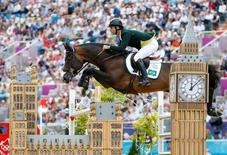Rodrigo Pessoa of Brazil riding Rebozo performs during the equestrian individual jumping final at the London 2012 Olympic Games in Greenwich Park August 8, 2012.    REUTERS/Jorge Silva
