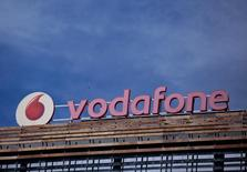 The Vodafone logo can be seen on top of a building outside Madrid, Spain, April 13, 2016. REUTERS/Andrea Comas