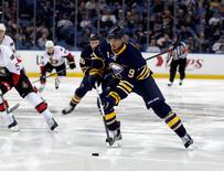 Mar 18, 2016; Buffalo, NY, USA; Buffalo Sabres left wing Evander Kane (9) skates up ice with the puck during the second period against the Ottawa Senators at First Niagara Center. Mandatory Credit: Timothy T. Ludwig-USA TODAY Sports