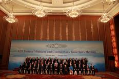 G20 Finance Ministers and Central Bank Governors pose for a group photo during a conference held in Chengdu in Southwestern China's Sichuan province, Sunday, July 24, 2016. REUTERS/Ng Han Guan