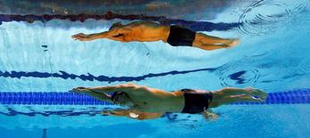 Michael Phelps of the U.S. is seen underwater as he swims in the men's 200m butterfly final during the London 2012 Olympic Games at the Aquatics Centre July 31, 2012. REUTERS/Michael Dalder/File photo
