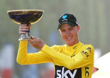 Cycling - Tour de France cycling race - The 113-km (70,4 miles) Stage 21 from Chantilly to Paris, France - 24/07/2016  - Yellow jersey leader and overall winner Team Sky rider Chris Froome of Britain reacts on the podium.       REUTERS/Juan Medina