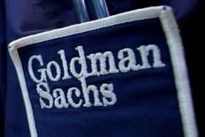 The logo of Dow Jones Industrial Average stock market index listed company Goldman Sachs (GS) is seen on the clothing of a trader working at the Goldman Sachs stall on the floor of the New York Stock Exchange, United States April 16, 2012. REUTERS/Brendan McDermid/File Photo   - RTSGB01