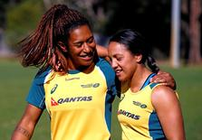 Members of the Australian Women's rugby sevens Olympic team Ellia Green (L) and Amy Turner embrace after a team training session in Sydney, Australia, July 22, 2016. Picture taken July 22, 2016. REUTERS/David Gray
