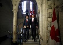 Canada's Prime Minister Justin Trudeau (L) and Finance Minister Bill Morneau walk to the House of Commons to deliver the budget on Parliament Hill in Ottawa, March 22, 2016. REUTERS/Patrick Doyle