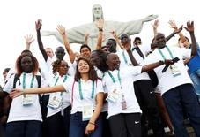 2016 Rio Olympics - Christ the Redeemer - 30/07/2016. Members of the Olympic refugee team including Yusra Mardini  from Syria (C) pose in front of Christ the Redeemer.   REUTERS/Kai Pfaffenbach