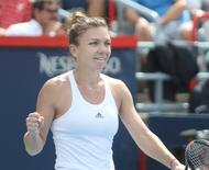 Jul 30, 2016; Montreal, Quebec, Canada; Simona Halep of Romania reacts after defeating Angelique Kerber (not pictured) of Germany on day six of the Rogers Cup tennis tournament at Uniprix Stadium. Mandatory Credit: Jean-Yves Ahern-USA TODAY Sports
