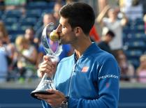 Jul 31, 2016; Toronto, Ontario, Canada;   Novak Djokovic of Serbia kisses the champions trophy after defeating Kei Nishikori of Japan to win the Rogers Cup tennis tournament at Aviva Centre. Mandatory Credit: Dan Hamilton-USA TODAY Sports