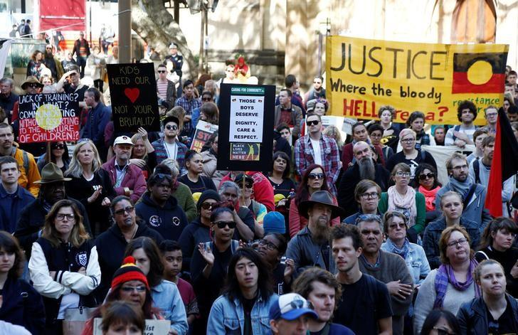 Demonstrators gather outside Sydney's Town Hall to protest against alleged child abuse in Australia's Northern Territory detention centers, July 30, 2016.      REUTERS/Jason Reed