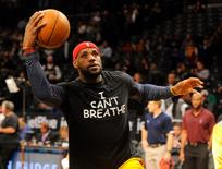 "Cleveland Cavaliers forward LeBron James wears an "" I Can't Breathe"" t-shirt during warm ups prior to the game against the Brooklyn Nets in Brooklyn, New York, December 8, 2014.  Most Americans want Olympic athletes to keep their political views to themselves at the Rio Games, according to a recent Reuters/Ipsos opinion poll.     Mandatory Credit: Robert Deutsch-USA TODAY Sports/File Photo - RTSKH3K"