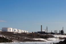 Storage containers and the Irving Oil refinery are seen in Saint John, New Brunswick, Canada March 8, 2014. REUTERS/Devaan Ingraham/File Photo - RTSGWFO