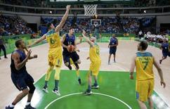 2016 Rio Olympics - Basketball - Preliminary - Men's Preliminary Round Group A Australia v France - Carioca Arena 1 - Rio de Janeiro, Brazil - 06/08/2016. Nando de Colo (FRA) of France drives between Andrew Bogut (AUS) of Australia and Aron Baynes (AUS) of Australia. REUTERS/Jim Young