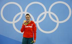 Rio Olympics - Swimming - Victory Ceremony - Women's 400m Individual Medley Victory Ceremony - Olympic Aquatics Stadium - Rio de Janeiro, Brazil - 06/08/2016. Katinka Hosszu (HUN) of Hungary celebrates her gold medal on the podium.  REUTERS/David Gray