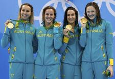 2016 Rio Olympics - Swimming - Victory Ceremony - Women's 4 x 100m Freestyle Relay Victory Ceremony - Olympic Aquatics Stadium - Rio de Janeiro, Brazil - 06/08/2016.  Emma McKeon (AUS) Brittany Elmslie (AUS)  Bronte Campbell (AUS) and Cate Campbell (AUS) of Australia pose with their medals.  REUTERS/Stefan Wermuth